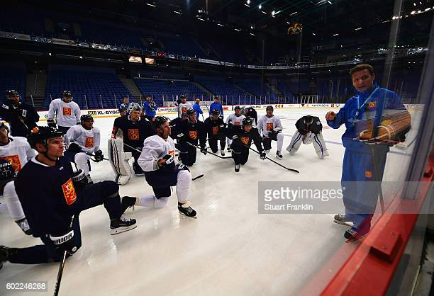 Lauri Marjamäki head coach of Finland gives his team instructions during practice for Team Finland at the Hartwell Areena on September 7 2016 in...