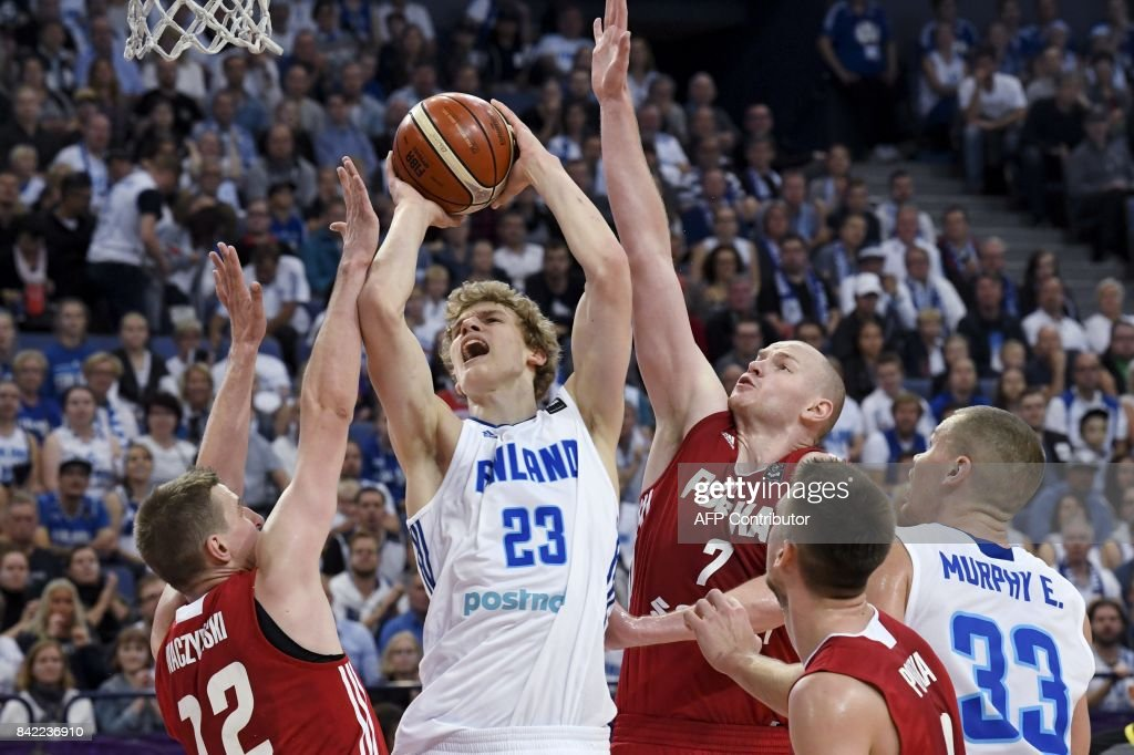 Lauri Markkanen (2L) of Finland goes up for the basket between Adam Waczynski (L), Damian Kulig and Mateusz Ponitka of Poland and Erik Murphy of Finland during the basketball European Championships Eurobasket 2017 qualification round match between Finland and Poland in Helsinki, Finland, on September 3, 2017. / AFP PHOTO / Lehtikuva / Jussi Nukari / Finland OUT