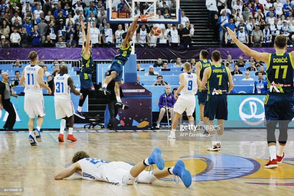 Lauri Markkanen of Finland lies on the floor after he lost control of the ball and Slovenia went on to score the game-winning basket during the basketball European Championships Eurobasket 2017 qualification round match between Finland and Slovenia in Helsinki, Finland, on September 2, 2017. / AFP PHOTO / Roni Rekomaa AND Lehtikuva / Roni Rekomaa / Finland OUT