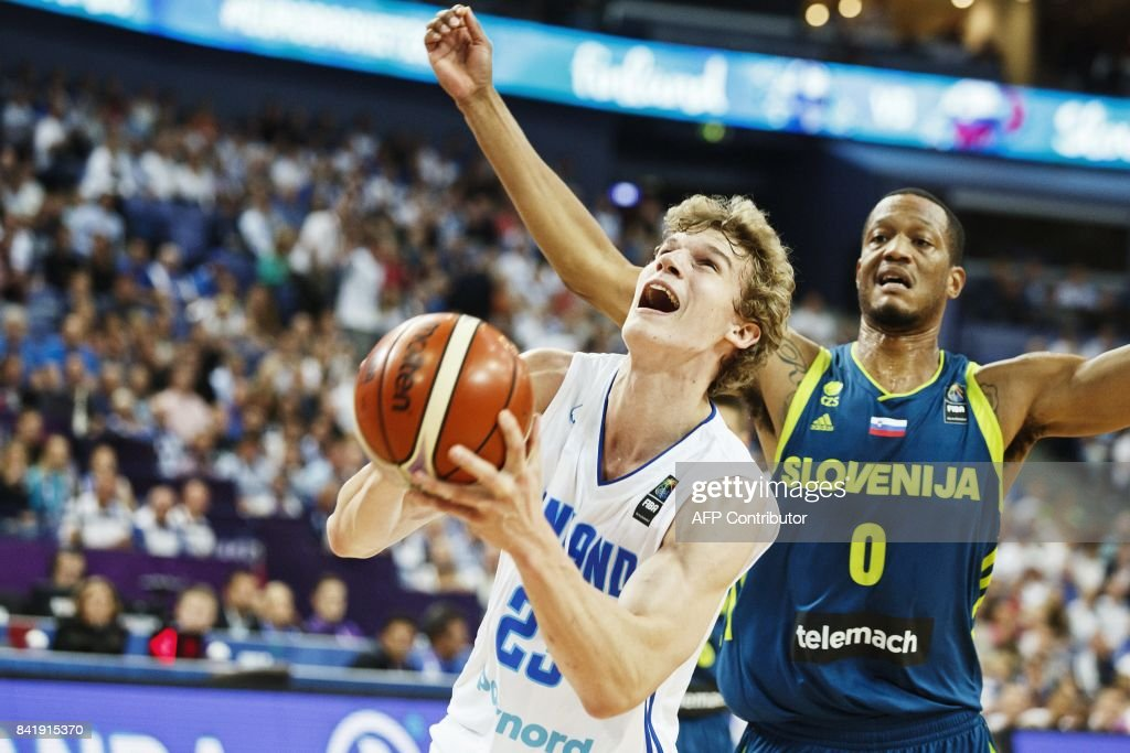 Lauri Markkanen (L) of Finland vies with Anthony Radolph of Slovenia during the basketball European Championships Eurobasket 2017 qualification round match between Finland and Slovenia in Helsinki, Finland, on September 2, 2017. / AFP PHOTO / Roni Rekomaa AND Lehtikuva / Roni Rekomaa / Finland OUT
