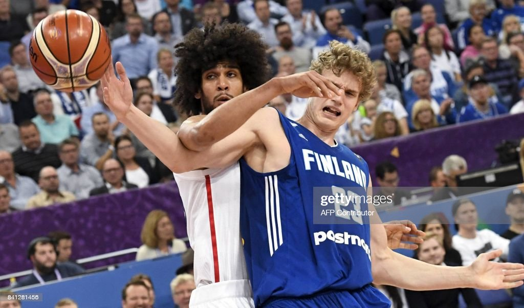 Lauri Markkanen of Finland (R) vies with Louis Labeyrie of France during the basketball European Championships Eurobasket 2017 qualification round Group A match France vs Finland in Helsinki, Finland on August 31, 2017. / AFP PHOTO / Lehtikuva / Jussi Nukari / Finland OUT