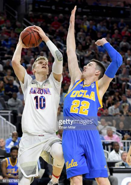 Lauri Markkanen of the Arizona Wildcats goes to the basket against TJ Leaf of the UCLA Bruins during a semifinal game of the Pac12 Basketball...