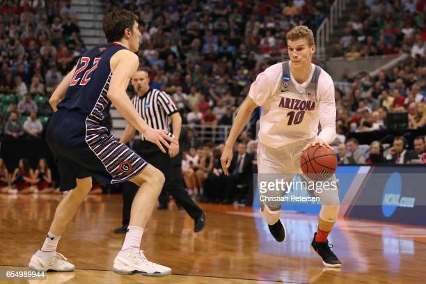 Lauri Markkanen of the Arizona Wildcats is defended by Dane Pineau of the St Mary's Gaels during the second round of the 2017 NCAA Men's Basketball...