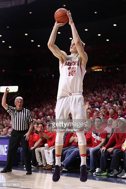 Lauri Markkanen of the Arizona Wildcats puts up a three point shot against the Arizona State Sun Devils during the first half of the college...