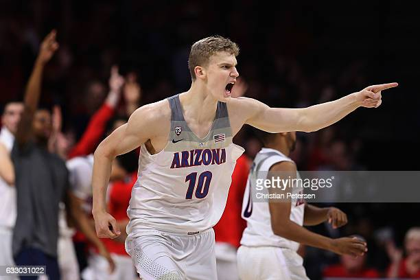 Lauri Markkanen of the Arizona Wildcats reacts after hitting a three point shot against the Washington Huskies during the second half of the college...