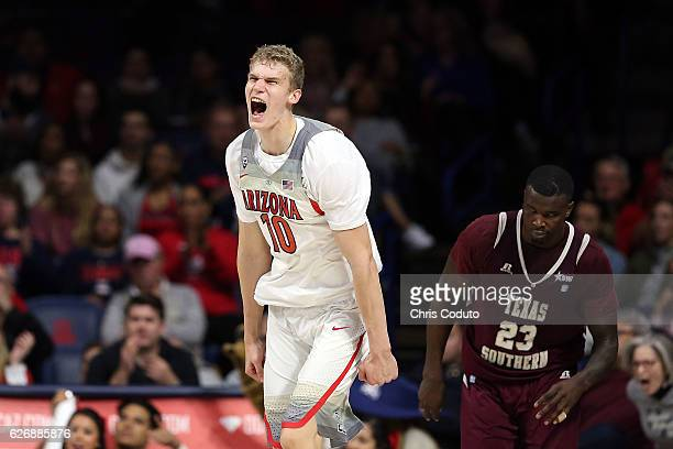 Lauri Markkanen of the Arizona Wildcats reacts after making a three point basket during the second half of the NCAA college basketball game against...