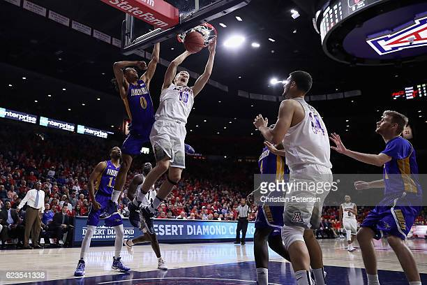 Lauri Markkanen of the Arizona Wildcats slam dunks the ball against Matt Smith of the Cal State Bakersfield Roadrunners during the first half of the...