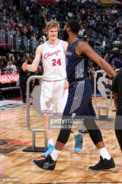 Lauri Markkanen of the Chicago Bulls and Andre Drummond of the Detroit Pistons high five during the Taco Bell Skills Challenge during State Farm...