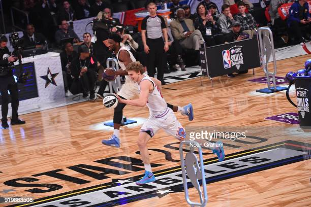 Lauri Markkanen of the Chicago Bulls and Joel Embiid of the Philadelphia 76ers participate in the Taco Bell Skills Challenge during State Farm...
