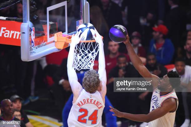 Lauri Markkanen of the Chicago Bulls and Joel Embiid of the Philadelphia 76ers compete in the 2018 Taco Bell Skills Challenge at Staples Center on...