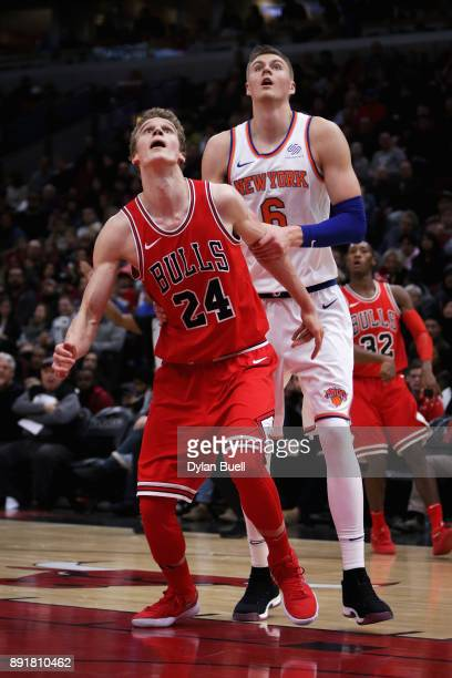 Lauri Markkanen of the Chicago Bulls and Kristaps Porzingis of the New York Knicks prepare to battle for a rebound in the third quarter at the United...