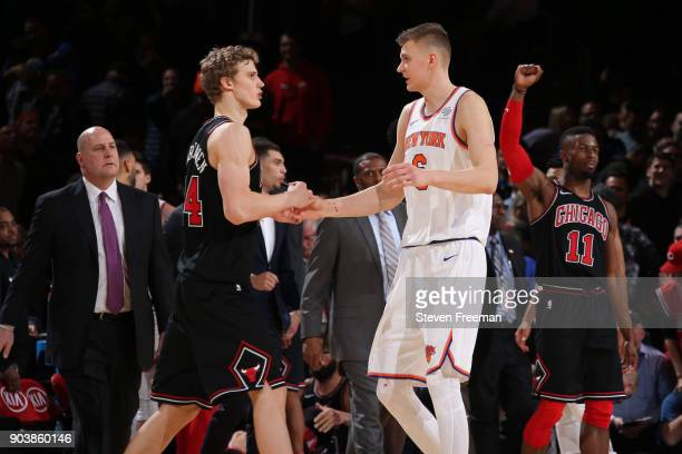 Lauri Markkanen of the Chicago Bulls and Kristaps Porzingis of the New York Knicks shake hands after the game on January 10 2018 at Madison Square...