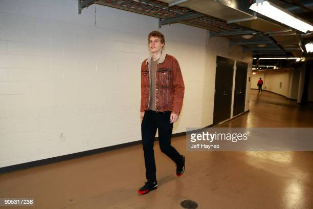 Lauri Markkanen of the Chicago Bulls arrives before the game against the Miami Heat on January 15 2018 at the United Center in Chicago Illinois NOTE...