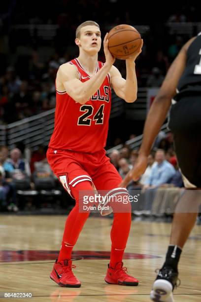 Lauri Markkanen of the Chicago Bulls attempts a shot in the first quarter against the San Antonio Spurs at the United Center on October 21 2017 in...