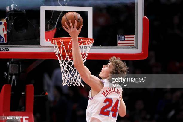 Lauri Markkanen of the Chicago Bulls attempts a shot in the first quarter against the Detroit Pistons at the United Center on April 11 2018 in...