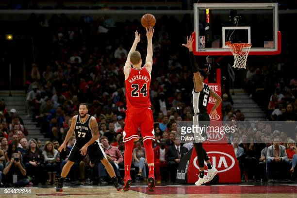 Lauri Markkanen of the Chicago Bulls attempts a shot in the fourth quarter against the San Antonio Spurs at the United Center on October 21 2017 in...