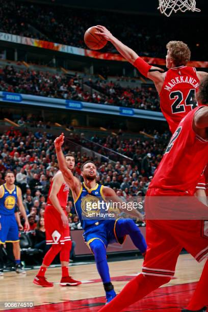 Lauri Markkanen of the Chicago Bulls blocks the shot of Stephen Curry of the Golden State Warriors on January 17 2018 at the United Center in Chicago...