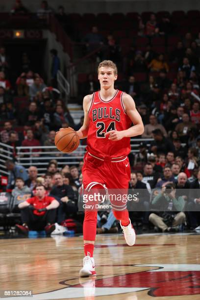 Lauri Markkanen of the Chicago Bulls brings the ball up court against the Phoenix Suns on November 28 2017 at the United Center in Chicago Illinois...