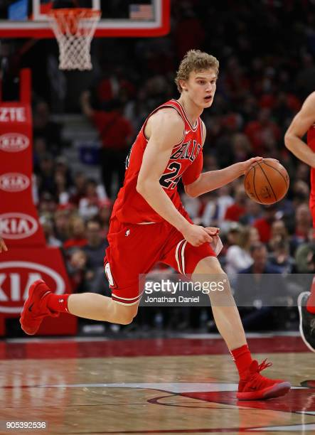 Lauri Markkanen of the Chicago Bulls brings the ball up the court against the Miami Heat at the United Center on January 15 2018 in Chicago Illinois...