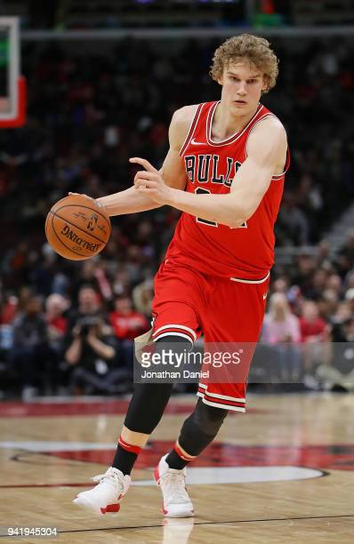Lauri Markkanen of the Chicago Bulls brings the ball up the court against the Charlotte Hornets at the United Center on April 3 2018 in Chicago...
