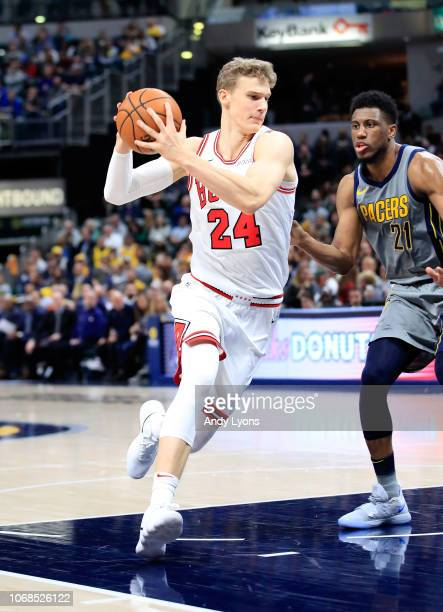 Lauri Markkanen of the Chicago Bulls dribbles the ball against the Indiana Pacers at Bankers Life Fieldhouse on December 4 2018 in Indianapolis...