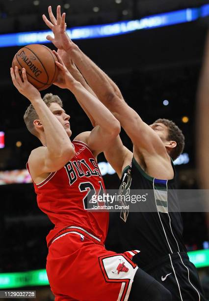 Lauri Markkanen of the Chicago Bulls drives against Brook Lopez of the Milwaukee Bucks at the United Center on February 11 2019 in Chicago Illinois...
