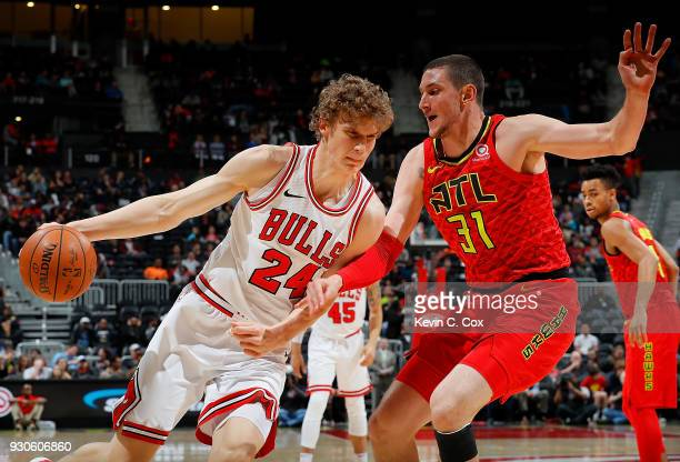Lauri Markkanen of the Chicago Bulls drives against Mike Muscala of the Atlanta Hawks at Philips Arena on March 11 2018 in Atlanta Georgia NOTE TO...