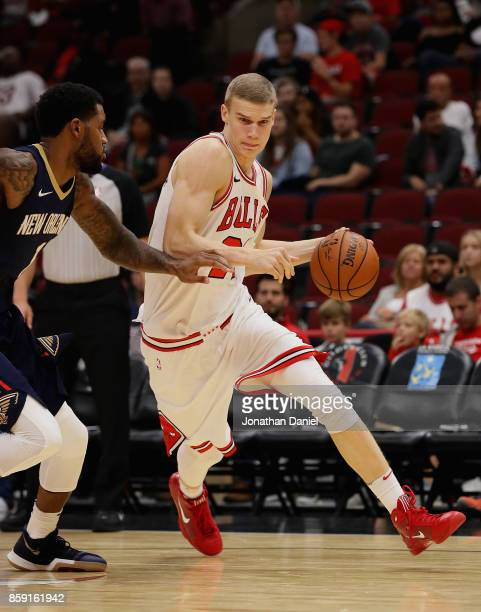 Lauri Markkanen of the Chicago Bulls drives against Perry Jones of the New Orleans Pelicans during a preseason game at the United Center on October 8...