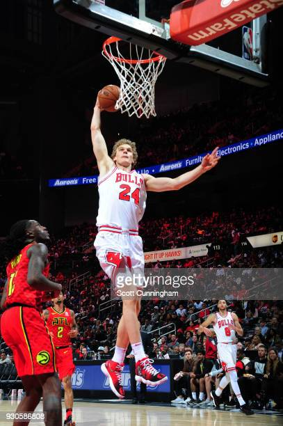 Lauri Markkanen of the Chicago Bulls dunks against the Atlanta Hawks on March 11 2018 at Philips Arena in Atlanta Georgia NOTE TO USER User expressly...