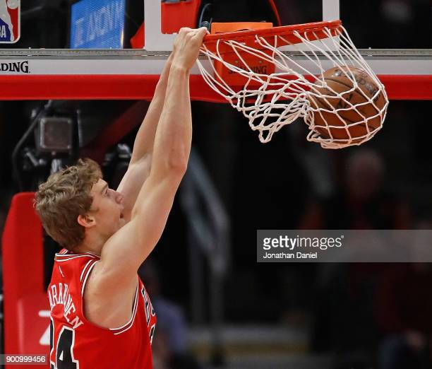 Lauri Markkanen of the Chicago Bulls dunks against the Toronto Raptors at the United Center on January 3 2018 in Chicago Illinois NOTE TO USER User...