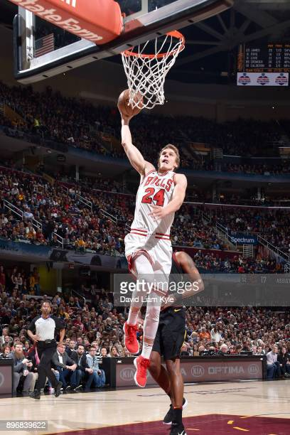 Lauri Markkanen of the Chicago Bulls dunks the ball during game against the Cleveland Cavaliers on December 21 2017 at Quicken Loans Arena in...