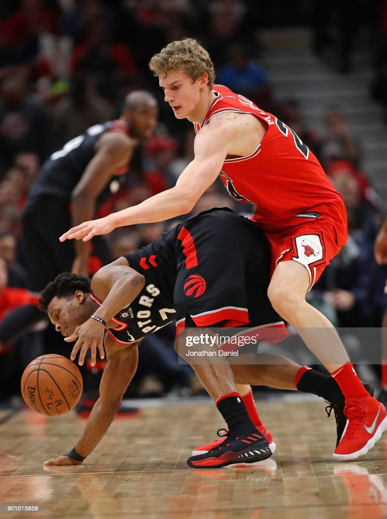 Lauri Markkanen #24 of the Chicago Bulls fouls Kyle Lowry #7 of the Toronto Raptors at the United Center on January 3, 2018 in Chicago, Illinois. The Raptors defeated the Bulls 124-115.