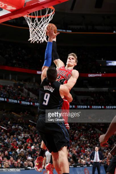 Lauri Markkanen of the Chicago Bulls goes for a dunk against the Orlando Magic on December 21 2018 at the United Center in Chicago Illinois NOTE TO...