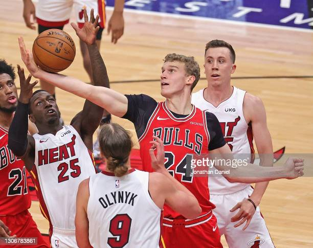 Lauri Markkanen of the Chicago Bulls grabs a rebound from Kendrick Nunn of the Miami Heat between Kelly Olynyk and Duncan Robinson at the United...