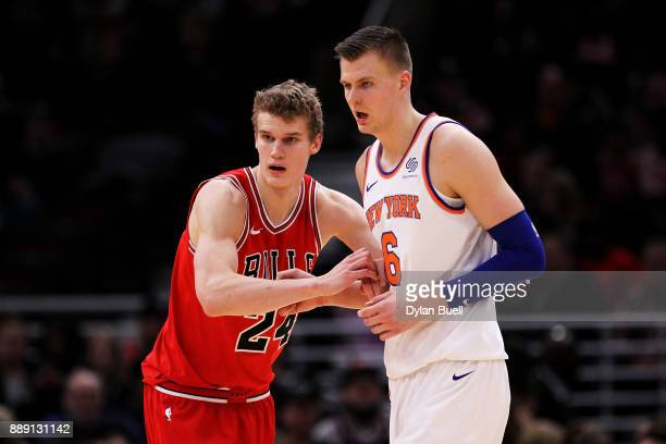 Lauri Markkanen of the Chicago Bulls guards against Kristaps Porzingis of the New York Knicks in the third quarter at the United Center on December 9...