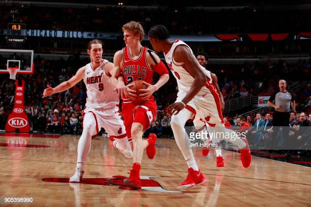 Lauri Markkanen of the Chicago Bulls handles the ball against Kelly Olynyk of the Miami Heat on January 15 2018 at the United Center in Chicago...