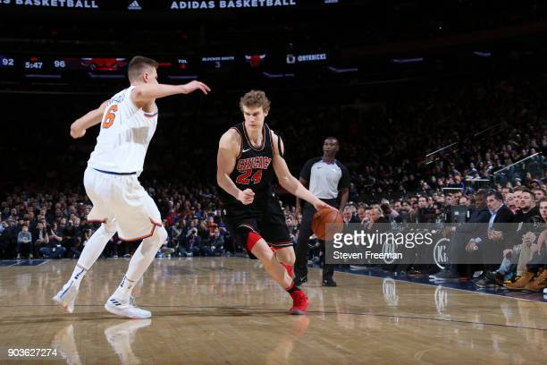 Lauri Markkanen of the Chicago Bulls handles the ball against Kristaps Porzingis of the New York Knicks on January 10 2018 at Madison Square Garden...