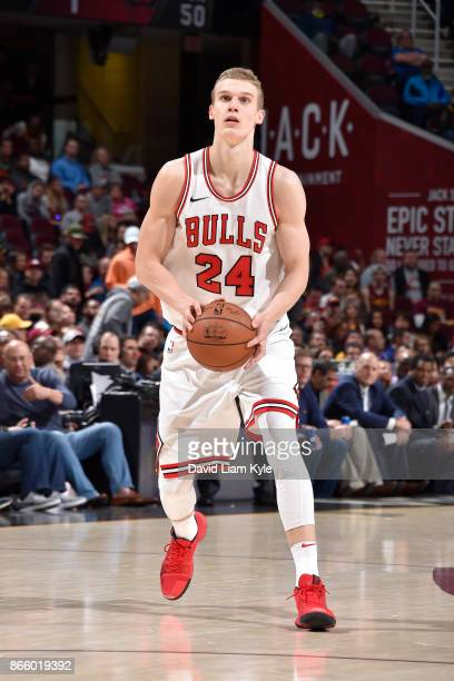 Lauri Markkanen of the Chicago Bulls handles the ball against the Cleveland Cavaliers on October 24 2017 at Quicken Loans Arena in Cleveland Ohio...