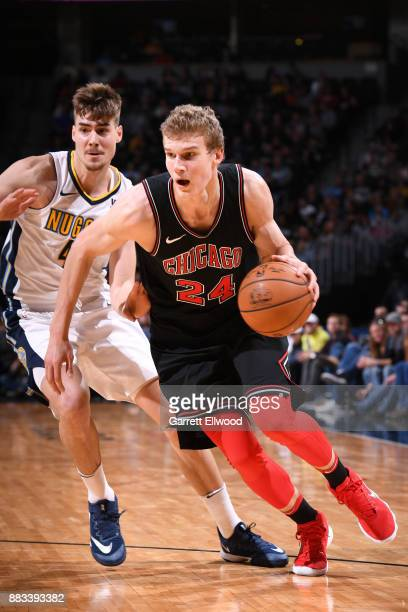 Lauri Markkanen of the Chicago Bulls handles the ball against the Denver Nuggets on November 30 2017 at the Pepsi Center in Denver Colorado NOTE TO...
