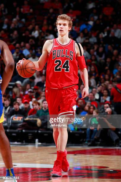 Lauri Markkanen of the Chicago Bulls handles the ball against the Golden State Warriors on January 17 2018 at the United Center in Chicago Illinois...