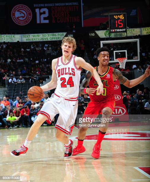 Lauri Markkanen of the Chicago Bulls handles the ball against the Atlanta Hawks on March 11 2018 at Philips Arena in Atlanta Georgia NOTE TO USER...