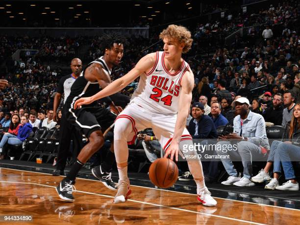 Lauri Markkanen of the Chicago Bulls handles the ball during the game against the Brooklyn Nets on April 9 2018 at Barclays Center in Brooklyn New...
