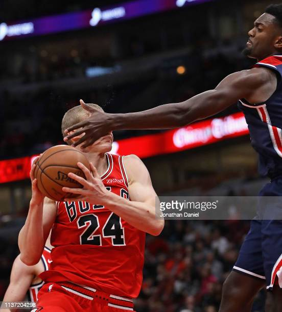 Lauri Markkanen of the Chicago Bulls is hit in the face by Bobby Portis of the Washington Wizards at the United Center on March 20 2019 in Chicago...