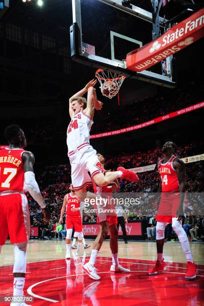 Lauri Markkanen of the Chicago Bulls lands a reverse dunks against the Atlanta Hawks on January 20 2018 at Philips Arena in Atlanta Georgia NOTE TO...