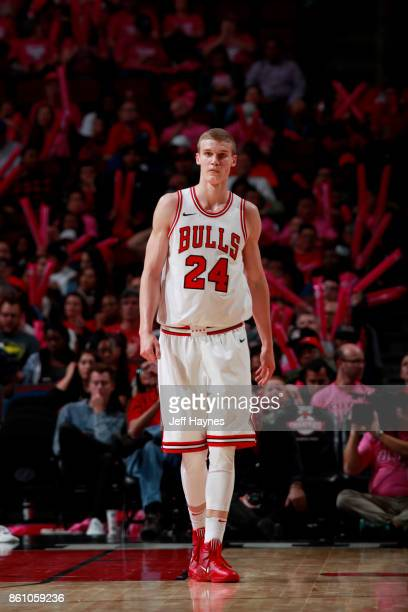 Lauri Markkanen of the Chicago Bulls looks on during the game against the Toronto Raptors on October 13 2017 at the United Center in Chicago Illinois...