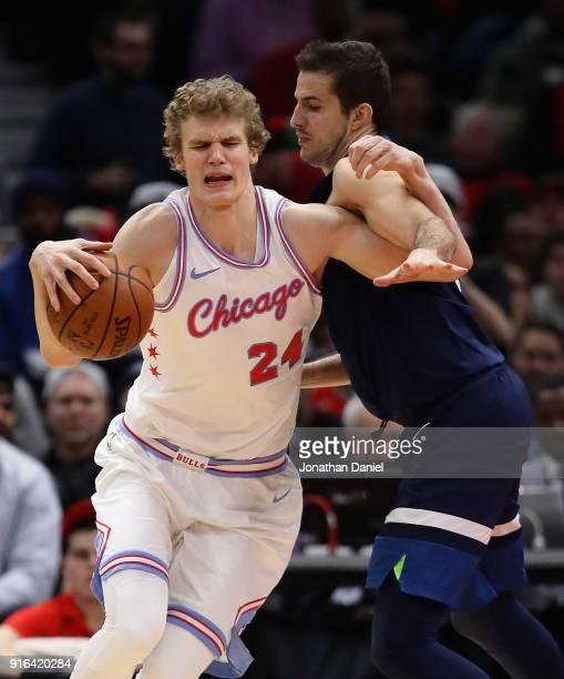 Lauri Markkanen of the Chicago Bulls moves against Nemanja Bjelica of the Minnesota Timberwolves at the United Center on February 9 2018 in Chicago...