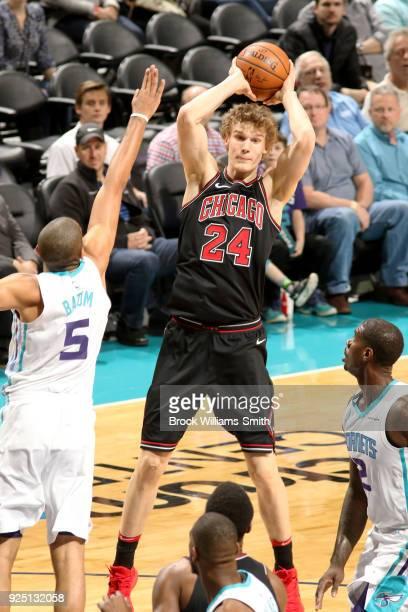 Lauri Markkanen of the Chicago Bulls passes the ball against the Charlotte Hornets on February 27 2018 at Spectrum Center in Charlotte North Carolina...