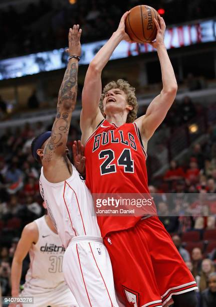 Lauri Markkanen of the Chicago Bulls puts up a shot against Mike Scott of the Washington Wizards on his way to a gamehigh 23 points at the United...