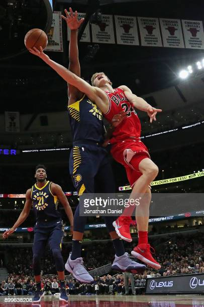 Lauri Markkanen of the Chicago Bulls puts up a shot against Myles Turner of the Indiana Pacers at the United Center on December 29 2017 in Chicago...