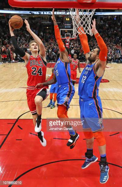Lauri Markkanen of the Chicago Bulls puts up the gamewinning shot against Paul George and Steven Adams of the Oklahoma City Thunder at the United...
